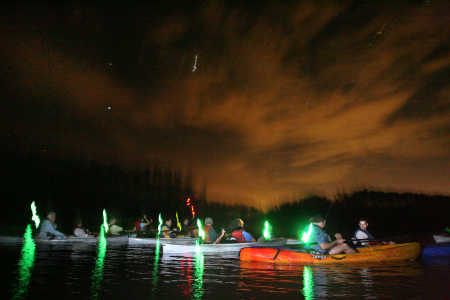 Bioluminescent kayaking in Florida comes with glow sticks at Mosquito Lagoon.
