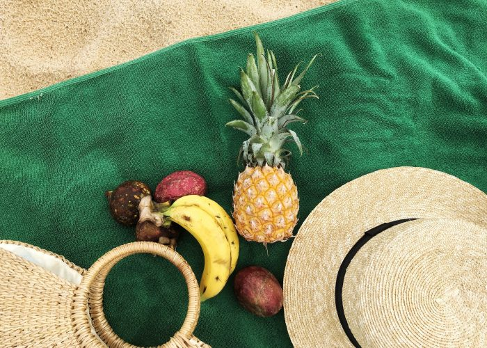 Summer picnic on the beach: green background